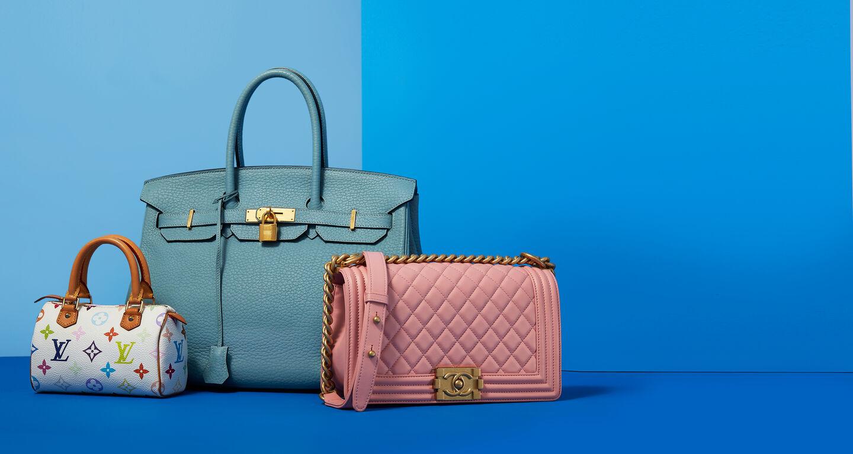 blue background with light blue birkin bag, pink chanel bag, multicolor louis vuitton
